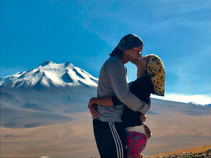 couple kissing in front of a mountain. Dancing in Colombia