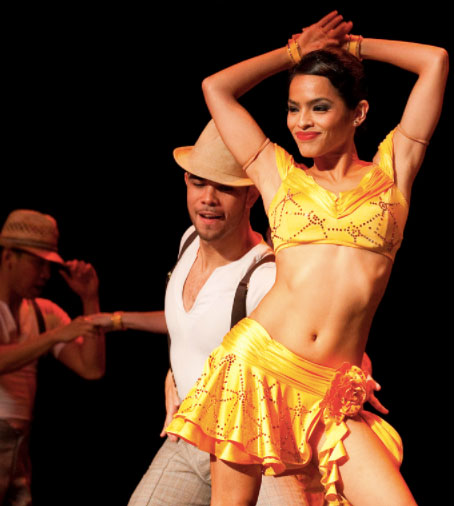Sexy Salsa dancer in a yellow costume