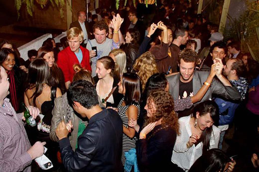 Image of a crew of locals and expats dancing at a salsa club in bogota.